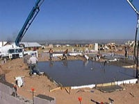 Slab pour using concrete boom pump