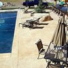 Random Stone, Sand Concrete Pool Decks Bomanite Corporation Madera, CA