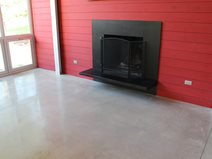 Polished Living Room Floor, Black Fireplace, Red Wall Concrete Sinks Dancer Concrete Design Fort Wayne, IN