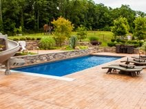 Pool Decking Options What S The Best Material For Around A Pool The Concrete Network