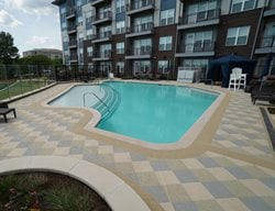 Colored Concrete, Concrete Overlay Concrete Pool Decks Sundek of Washington Chantilly, VA