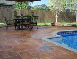 Fleur De Lis, Stained, Faux Grout Concrete Pool Decks Artistic Concrete Floors LLC Madisonville, LA