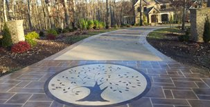 Decorative Overlay Engraved With A Circular Tree Motif Concrete Driveways Champney Concrete Finishing Lynchburg, VA
