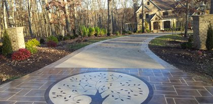 Concrete Driveway Design Ideas stamped concrete patterns Decorative Overlay Engraved With A Circular Tree Motif Site Champney Concrete Finishing Lynchburg Va