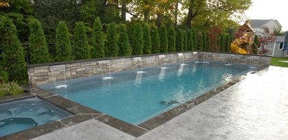 colored concrete pool decks - installing a colored swimming pool