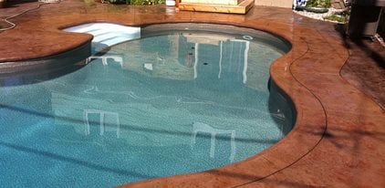 Concrete pool deck design ideas the concrete network for Painting aluminum swimming pool coping