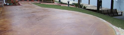 Red Stain, Sawcut Grout Lines Concrete Patios Artistic Concrete Floors LLC Covington, LA