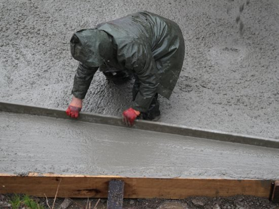 pouring concrete in rain