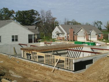 Concrete basement construction information benefits to for Building a basement foundation