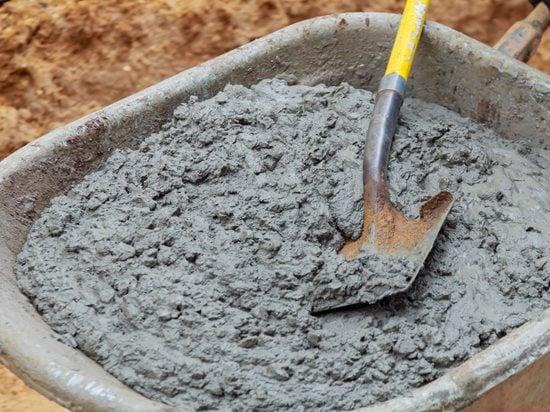 Mixing Concrete, Wheelbarrow, Shovel Site Shutterstock