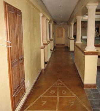 Concrete Shuffleboard Transforms Unfinished Basement Floor