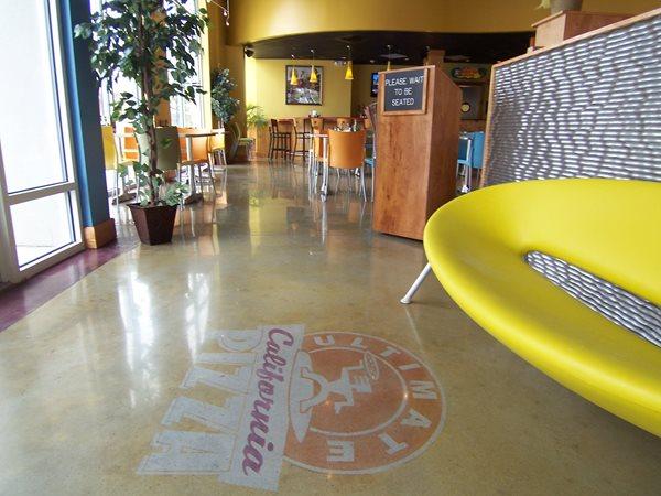 Pizza Parlor Entry Floor, Decorative Concrete Logo Commercial Floors Surface Design Solutions Atlanta, GA