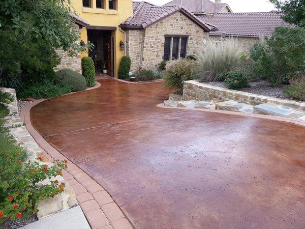 Brown Stain, Rock Salt Finish Concrete Driveways All Innovative Concrete Austin, TX