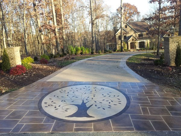 Decorative Overlay Engraved With A Circular Tree Motif Concrete Driveways Champney Concrete Finishing Lynchburg, VA