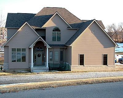 Brown, Colonial Home Concrete Homes RP Watkins, Inc. Omaha, NE