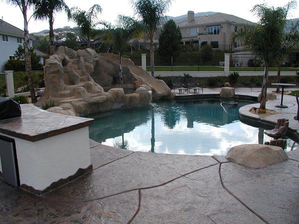 Brown, Large Stones Concrete Pool Decks Surfacing Solutions Inc Temecula, CA