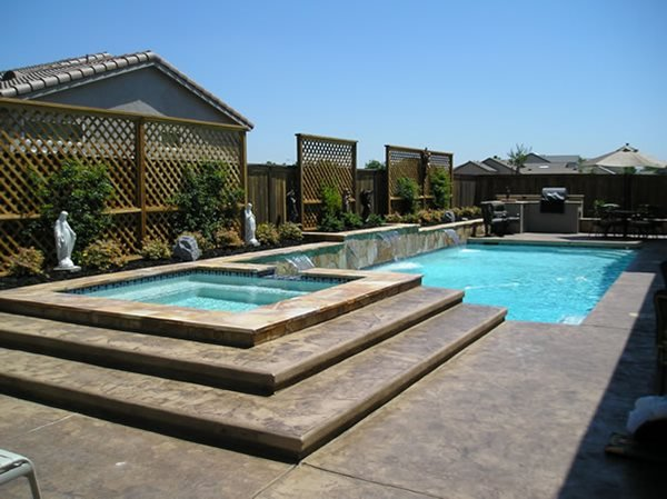 California Pool Concrete Pool Decks Rhodes Landscape Design, Inc Rio Linda, CA