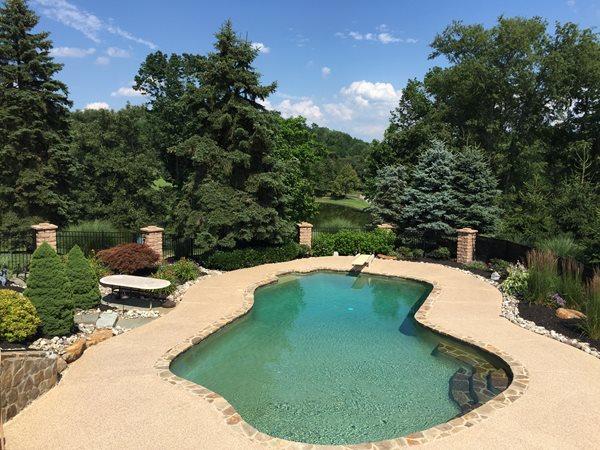 Exposed Aggregate, Swimming Pool, Stone Coping Concrete Pool Decks Complete Concrete Systems Milton, DE