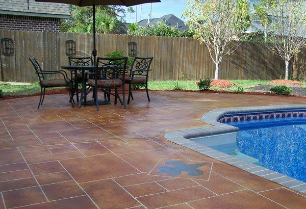 Fleur De Lis, Stained, Faux Grout Concrete Pool Decks Artistic Concrete Floors LLC Madisonville, LA