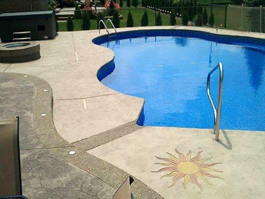 Pool Deck, Sun Stencil, Blue Water, Trees Concrete Pool Decks G.T. Concrete and Decorative Work Clinton Twp, MI