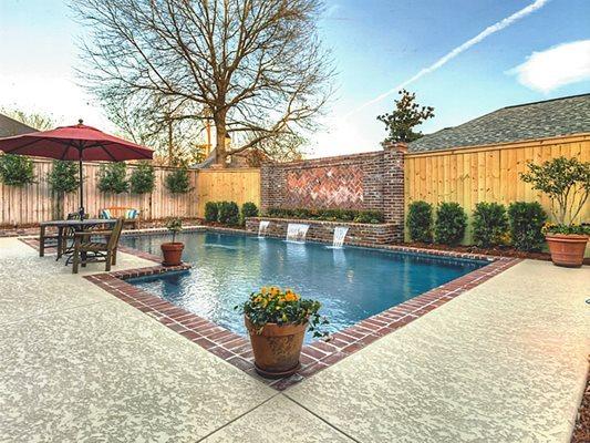 Pool Deck, Texrured, Waterfall Concrete Pool Decks Sundek Concrete Coatings, Inc. New Orleans, LA