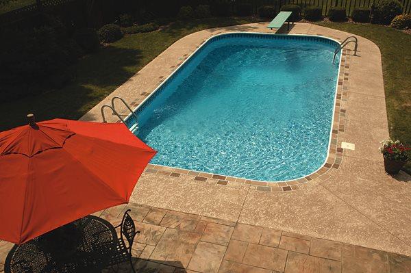 Tan, Title Border Concrete Pool Decks L.M. Scofield Company Douglasville, GA