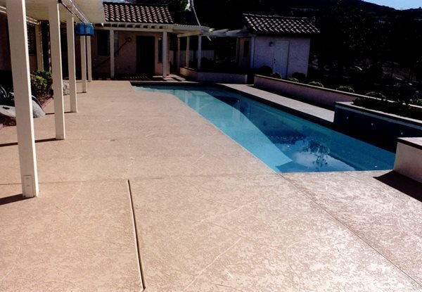 Textured, Tan Concrete Pool Decks Concrete Solutions Products by Rhino Linings® San Diego, CA