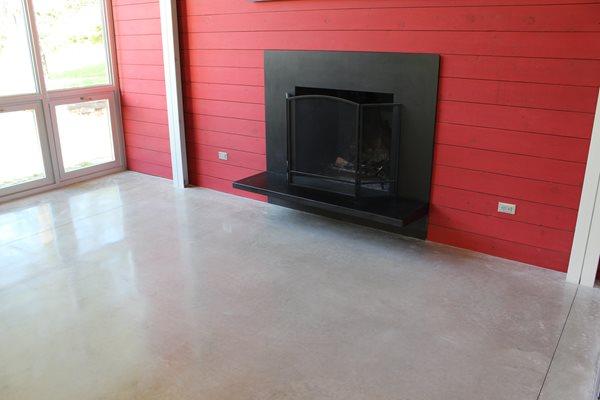 Polished Living Room Floor, Black Fireplace, Red Wall Polished Concrete Dancer Concrete Design Fort Wayne, IN