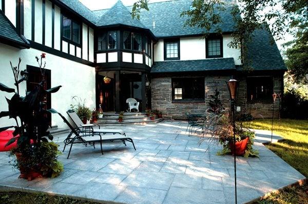 Tudor Style Home, Stamped Backyard Patio Stamped Concrete L.M. Scofield Company Douglasville, GA