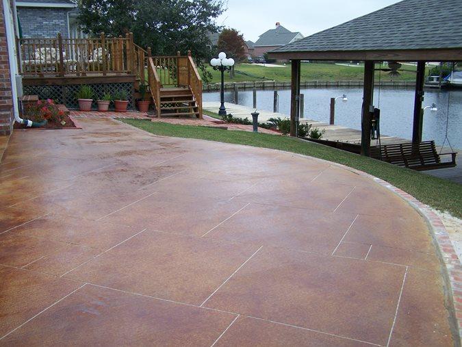 Red Stain, Sawcut Grout Lines Concrete Patios Artistic Concrete Floors LLC Madisonville, LA