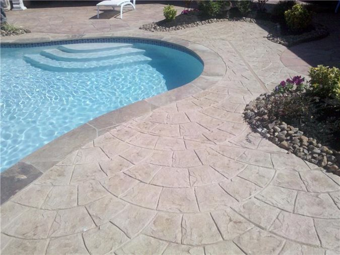 Photo gallery concrete pool decks humble tx the for Pool deck ideas made from concrete