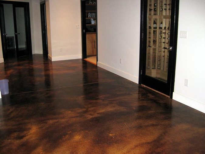 this basement floor was colored with an acid stain in coffee brown