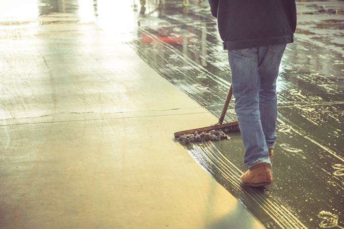 Cleaning Concrete Floor Site Shutterstock