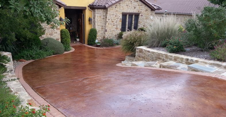 Brown Stain, Rock Salt Finish Concrete Driveways All Innovative Concrete Austin, TX