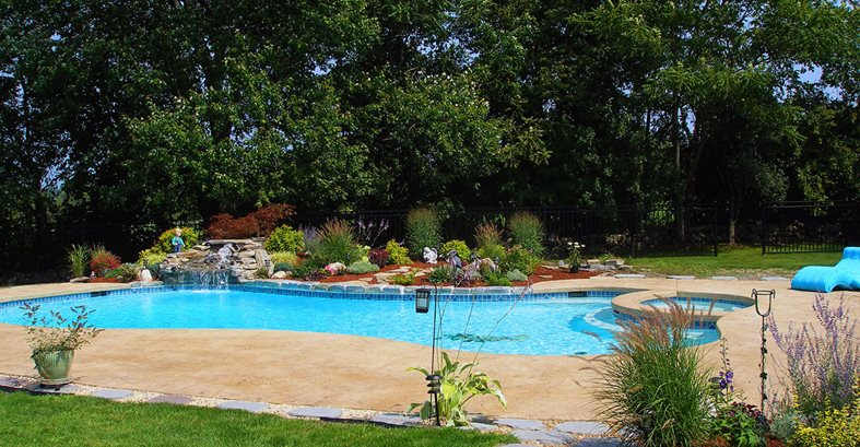 Pool Deck, Trees, Blue Water Concrete Pool Decks GMS Decorative Concrete Nashua, NH