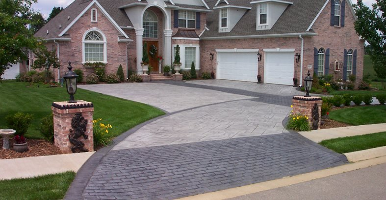 Concrete Driveway Design Ideas give your concrete a finished look with a bordered edge just adding the element of a 6 border will make your driveway look more elegant Brick And Concrete Driveway Patterned Drive Concrete Pattern Driveway Concrete Driveways Ozark Pattern Concrete