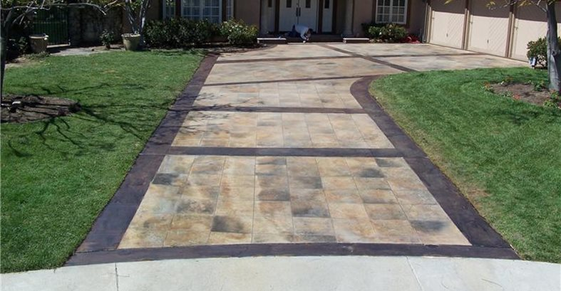 Stained And Sawcut Concrete Driveway Takes On Look Of