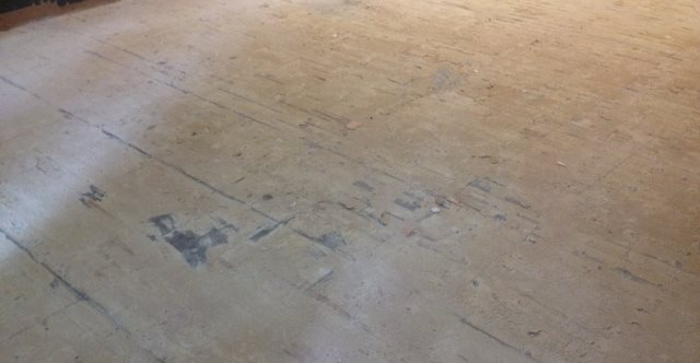 Before Of A Stained Commercial Concrete Floor Site Atlanta Concrete Artist Alpharetta, GA