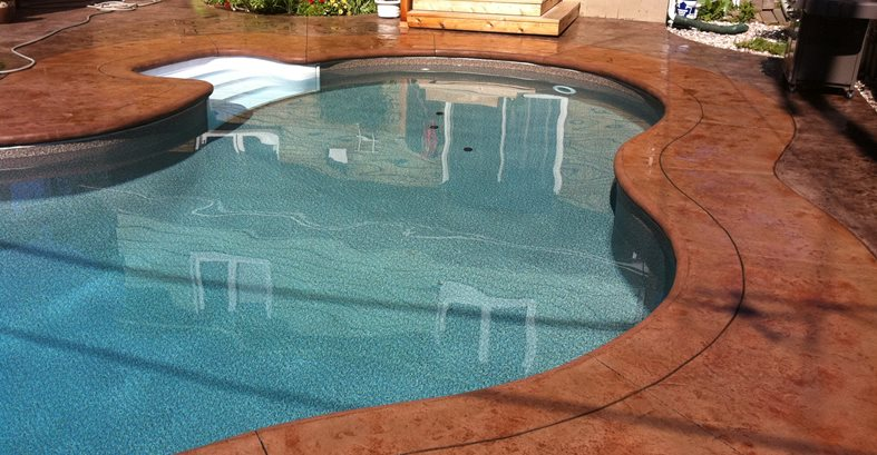Stamped concrete pool deck border the concrete network for Inground pool coping paint