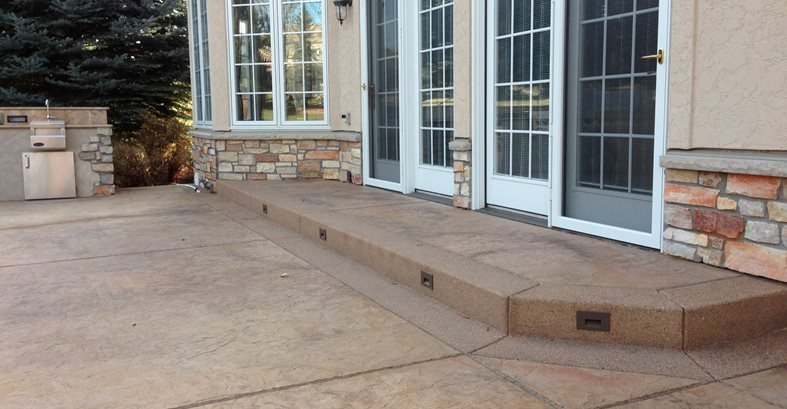 Brown Stamped Concrete Patio Stamped Concrete Diehl Concrete Sedalia, CO.  Stamped Concrete Patio With Decorative Exposed Aggregate Border.