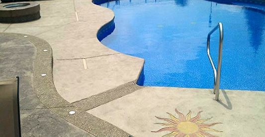 Pool Deck, Sun Stencil, Blue Water, Trees Concrete Pool Decks G.T. Concrete and Decorative Work Clinton Twp, MI