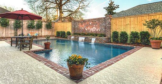 Pool Deck, Texrured, Waterfall Concrete Pool Decks Sundek of Houston Katy, TX