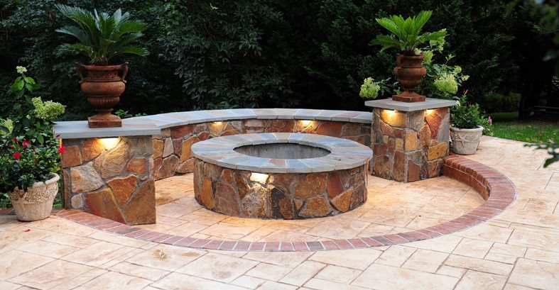 brick fire pit on concrete patio seat wall stamped custom bowl gas block designs