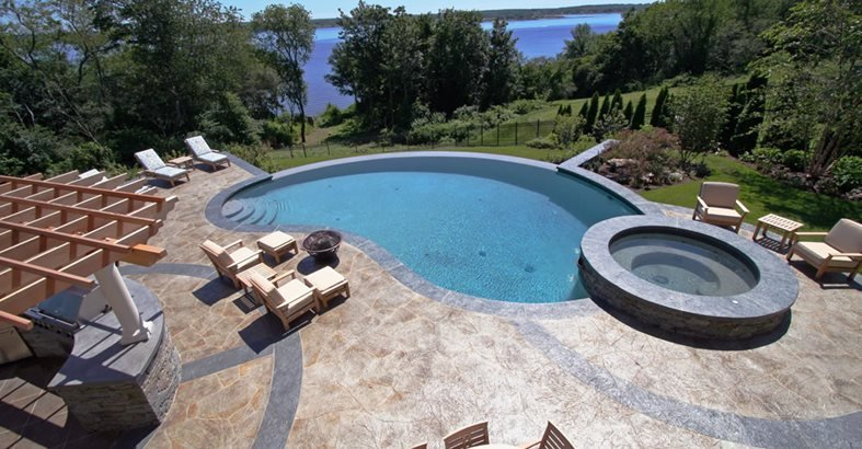 Swimming Pool Deck Design hypnotic design a pool deck with wooden bench table outdoor also intex inflatable whale ride on swimming pool toy from pool tiles pool decks pool coping Concrete Pool Decks New England Hardscapes Inc Acton Ma