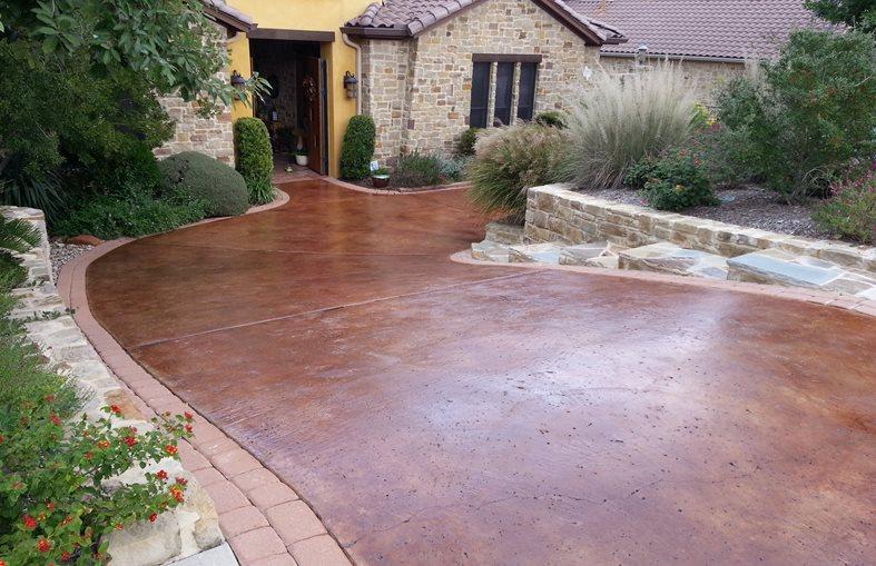 Brown Stain, Rock Salt Finish Stamped Concrete All Innovative Concrete Austin, TX